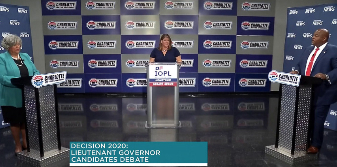 Candidates for lieutenant governor — Democratic state Rep. Yvonne Lewis Holley, left, and Republican Mark Robinson, right —debate at the Charlotte Motor Speedway as part of the N.C. Institute of Political Leadership's Hometown Debate series. At center is Spectrum News NC moderator Loretta Boniti (screen shot from Spectrum News).