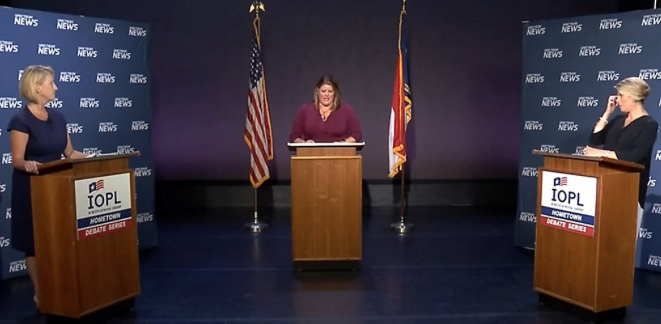 Candidates for superintendent of public instruction face off at a Hometown Debate sponsored by the N.C. Institute of Political Leadership. On the stage are, from left, Republican Catherine Truitt, Spectrum News NC moderator Loretta Boniti; and Democrat Jennifer Mangrum. (Screenshot from Spectrum News)