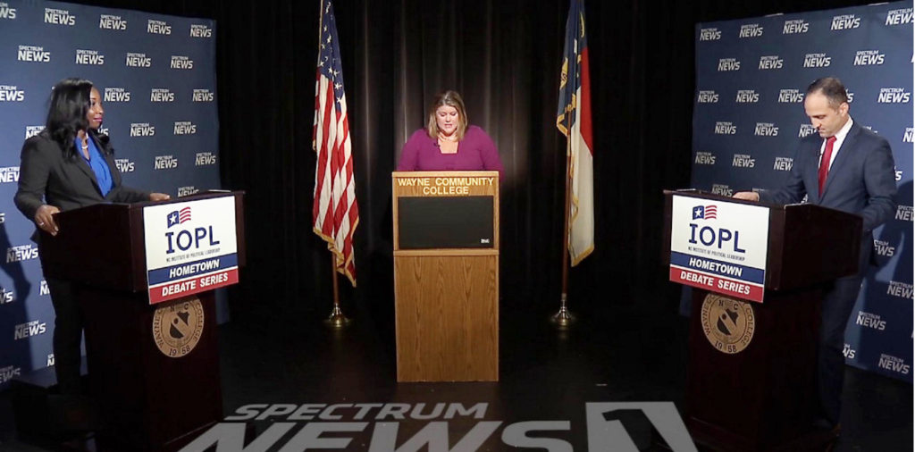 Democrat Jessica Holmes, at left, and Republican Josh Dobson, right, debate in the Spectrum News One Hometown Debate series in the race for N.C. Commissioner of Labor. At center is Spectrum News anchor and moderator Loretta Boniti. (Screenshot from Spectrum News)
