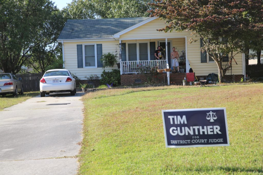 The Fuquay Varina house where Tim Gunther is registered to vote. On the porch, shirtless, is Rex Jacobson, the boyfriend of Gunther's daughter. (CJ photo by Don Carrington)