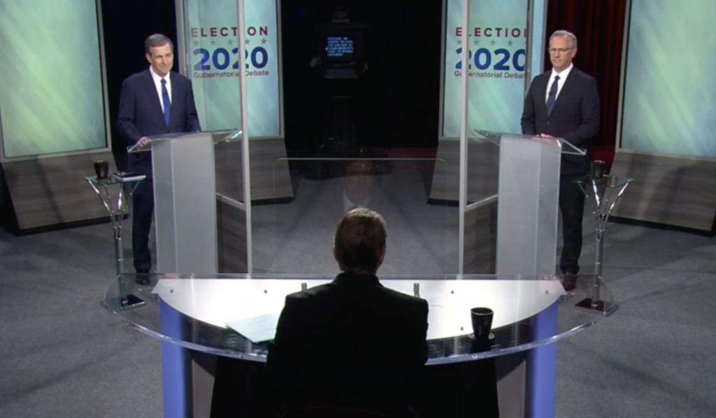 Gov. Roy Cooper, left, and Lt. Gov. Dan Forest debate Wednesday, Oct. 14, at UNC-TV studios. The moderator, at center, is Wes Goforth. (screenshot from pool)