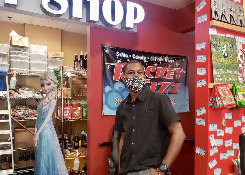 Cyrus Glass, owner of Rocket Fizz Soda Pop & Candy Shop near Fayetteville Street in Raleigh, is prepared to defend his store if needed. (CJ photo by Lindsay Marchello)