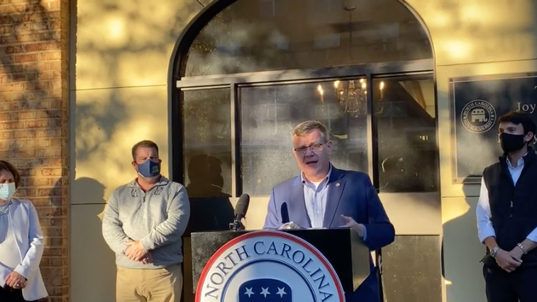 House Speaker Tim Moore, R-Cleveland, speaks at a Nov. 16 news conference at N.C. Republican Party headquarters in Raleigh. He is flanked by the GOP leadership members for the 2021 General Assembly. From left, Speaker Pro Tem Sarah Stevens, R-Surry; Deputy Majority Leader Brenden Jones, R-Columbus; and Majority Whip Jon Hardister, R-Guilford. (Facebook screenshot)