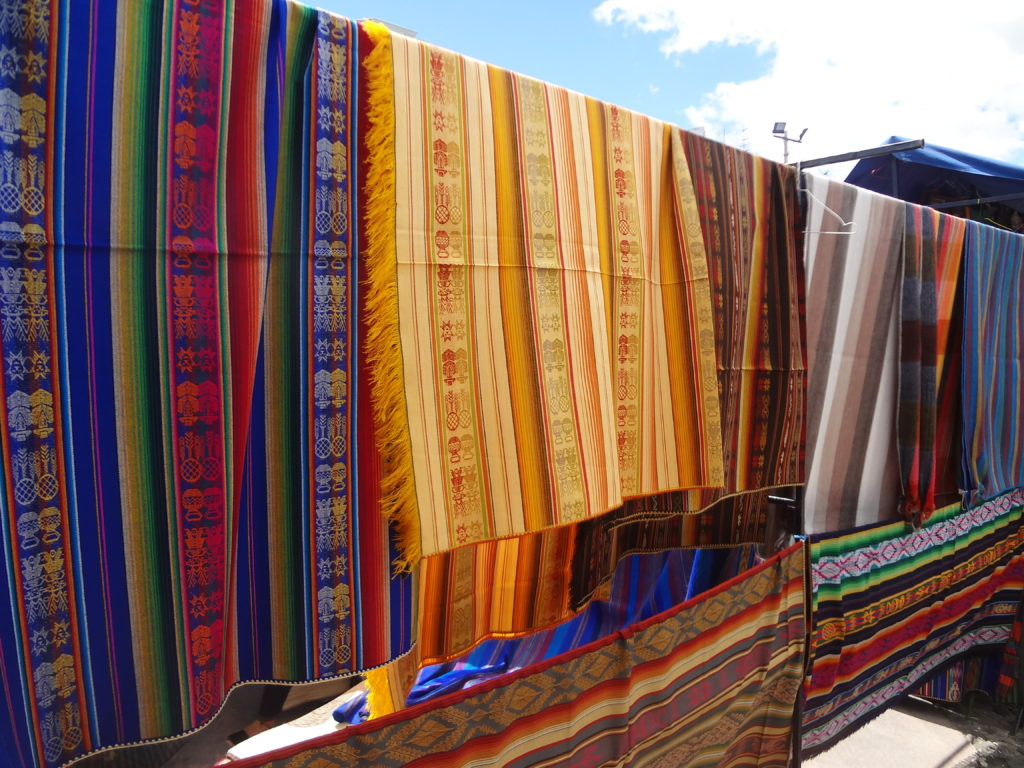 Textiles at the Otalvo Artisanal Market in the Andes. (By David Adam Kess — Creative Commons Attribution, wikimedia.org)