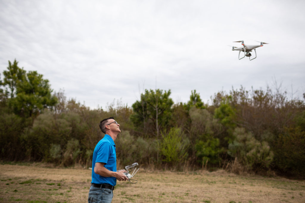 Co-author Michael Jones flying a drone. (Image provided by Institute for Justice)