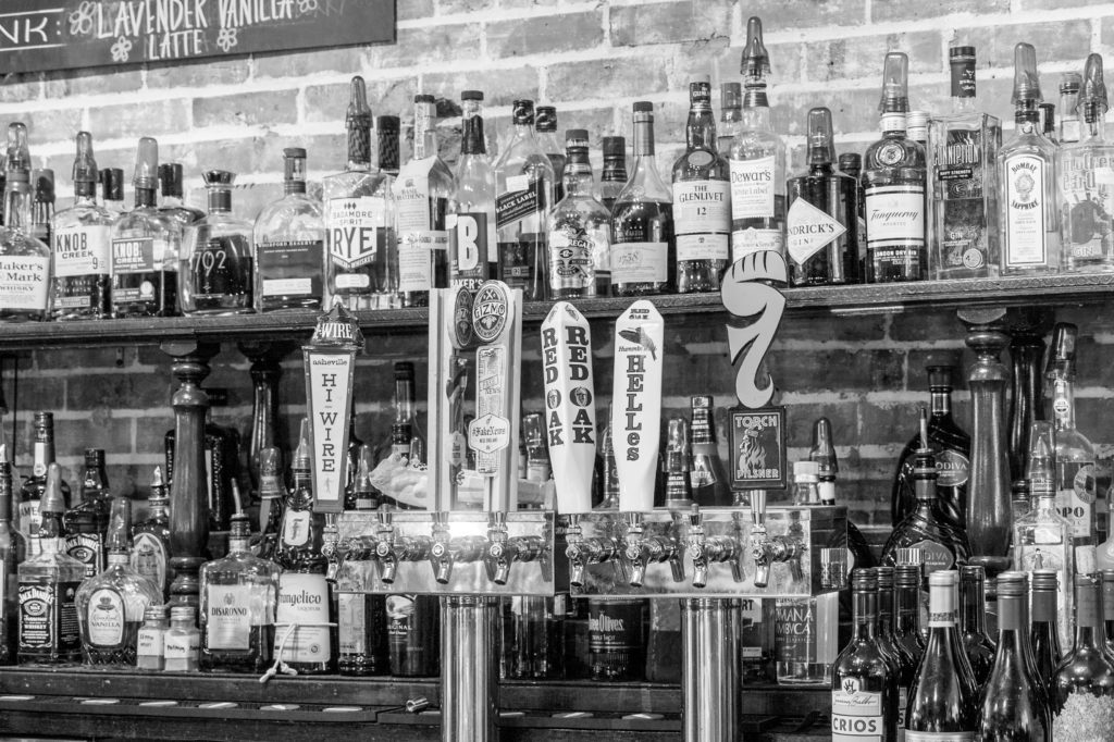 black and white liquor bottles are displayed in a chapel hill bar. Image by Carolina Journal