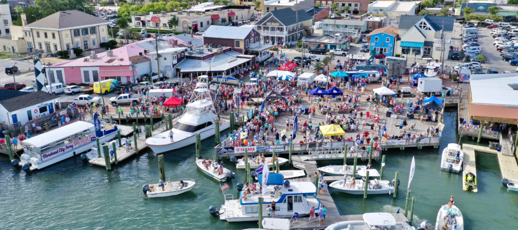 Crowds gather by land and by sea for the 63rd Annual 2021 Big Rock Blue Marlin Tournament. Photo via thebigrock.com