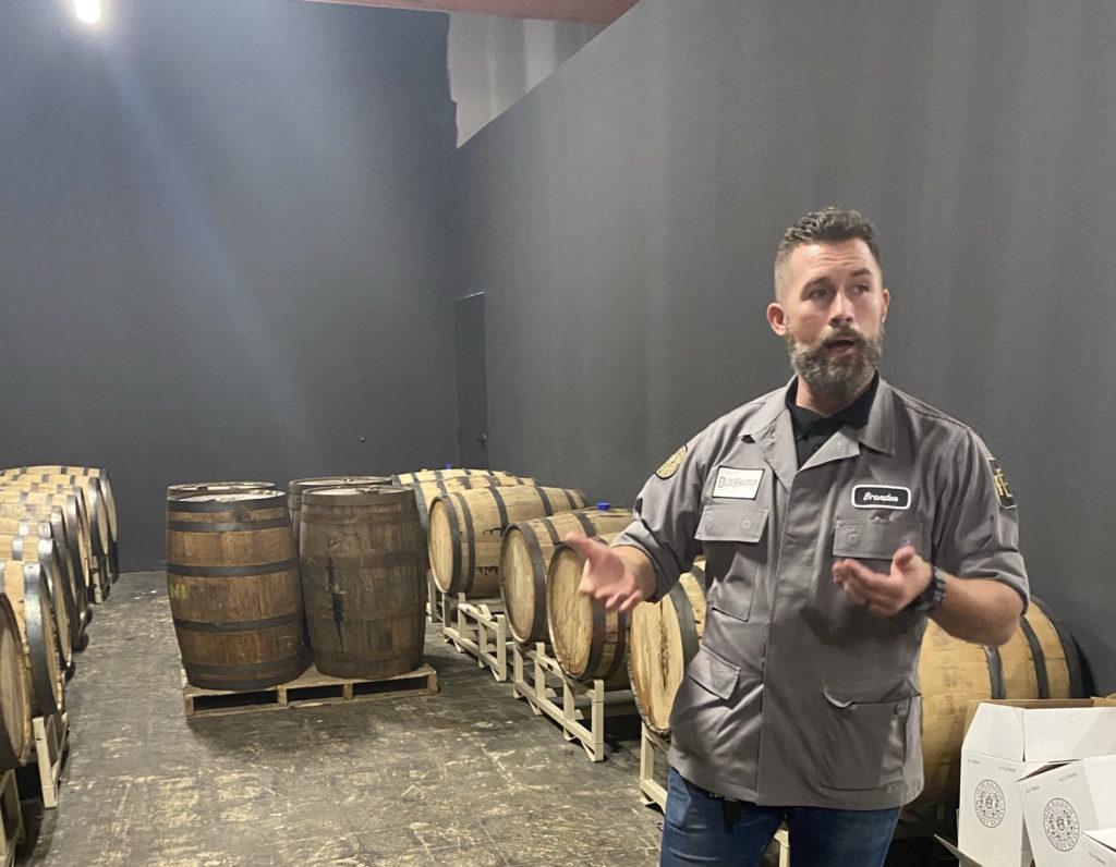 Brandon McCraney, in his distillery in Zebulon. (Photo by Lisa Snedeker)