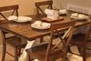 """5.5' x 37"""" Trestle Table, no apron, with a traditional top, stained in Dark Walnut with an Ivory Base. Pictured with X-Back dining chars."""
