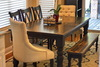 Double X-Back Wood Dining Chairs painted Black and stained Midnight on the seat with a Baluster Turned Leg Table.