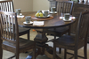 Jane Wood Dining Chairs stained Dark Walnut with a Round Pedestal Table and Farmhouse Buffet and Hutch