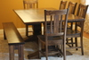 William Wood Dining Chairs stained Dark Walnut with an Heirloom Pedestal Table and a Farmhouse Bench