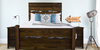 Queen Live Edge Bed with Extra Tall Headboard and Footboard in Dark Walnut stain. Pictured with boxspring.