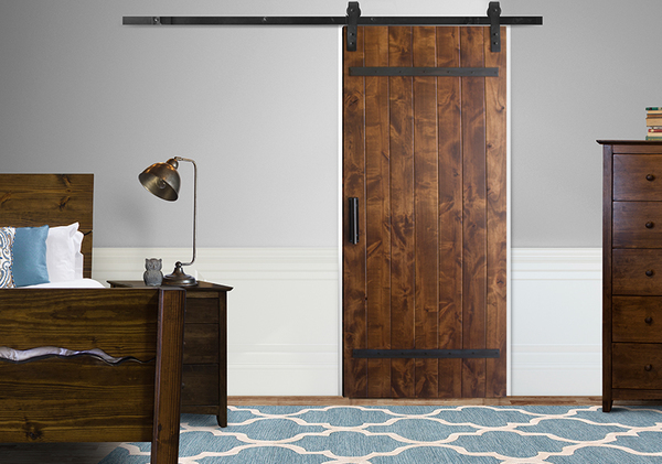 "Industrial Barn Door Kit at 34"" Wide and 84"" Tall in Tuscany Finish with Flat Black hardware."