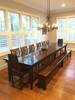 William Wood Dining Chair stained Dark Walnut. Pictured with a Farmhouse Table and bench.
