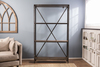 "Factory Metal Bookshelf featuring four shelves in Dark Walnut stain. This shelving unit features industrial steel and rivet details. 48"" W x 11.25"" D x 81"" H."
