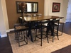 "6.5' X 42"" X 42"" H Steel X Base Dining Table with a jointed top stained Dark Walnut and black painted steel base."