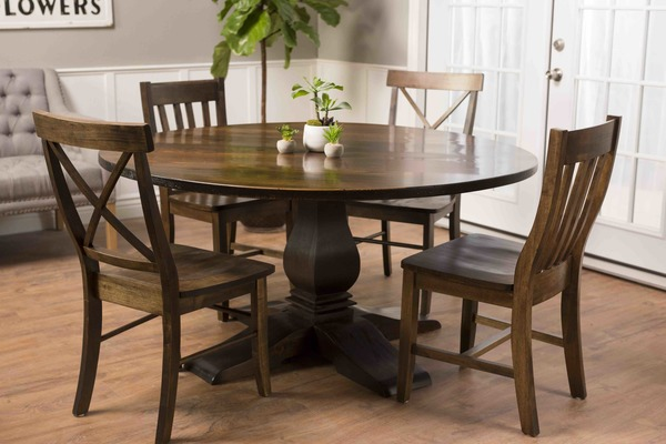 """60"""" Round Heirloom Pedestal Dining Table stained Dark Walnut with a satin finish. Pictured with X-Back Wood Chairs and Henry Wood Chairs. Dove Grey Tufted Linen Settee pictured in background."""