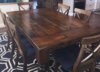 "6' L x 45"" W Baluster Turned Leg Table with a traditional top and endcaps in Dark Walnut stain. Paired with X-Back Dining Chairs."