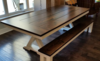 """8' L x 45"""" W Trestle Table with an apron and a traditional top with endcaps in Dark Walnut stain with an Ivory painted base. Paired with a matching Farmhouse Dining Bench."""