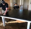 """66"""" x 66"""" Square Farmhouse Table with a jointed top in Dark Walnut stain and an Ivory painted base."""