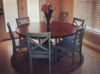 "60"" Round Pedestal Table stained in Kona with a Semi-Gloss Sheen."