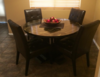 """48"""" Round Farmhouse Table with a Vintage Midnight stained table top."""
