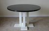 """48"""" Round Farmhouse table stained in Midnight with an Ivory painted base."""