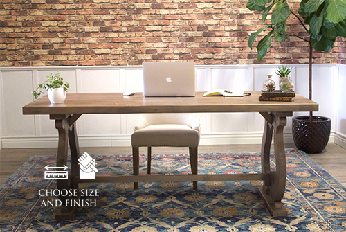 Carved Trestle Writing Desk in Barn Wood Finish.