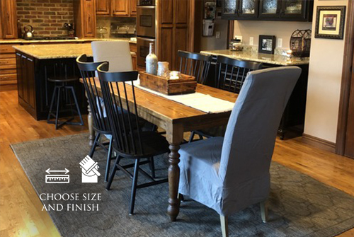 "6' L x 37"" W Country French Turned Leg Table with a traditional top in Early American stain and a satin sheen. Paired with extra tall Rustic Windsor Dining Chairs in black."