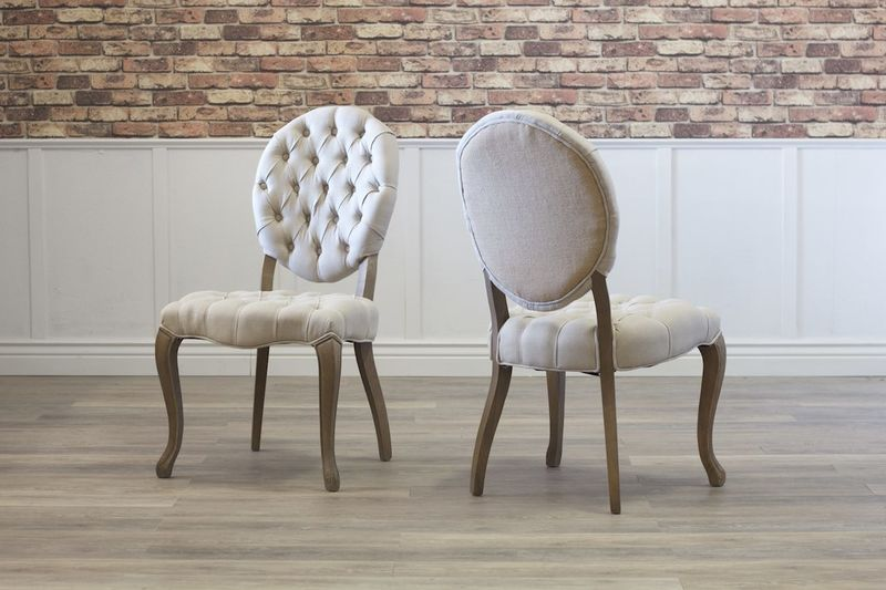 Sophie Round Tufted Linen Chairs.