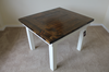 """46"""" x 46"""" Square Farmhouse Table with a traditional top and endcaps stained in Dark Walnut with a Semi-Gloss Sheen and an Ivory painted base."""