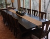 Grace Chairs in Kona Stain paired with a 12' L Heirloom Pedestal Table.