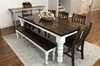 """7' L x 37"""" W x 30"""" H Baluster Table with a traditional tabletop stained Dark Walnut with an Ivory painted base. Pictured with a Dianne Bench and Henry Dining Chairs."""