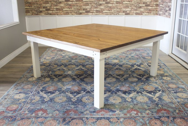 "66"" x 66"" Square Farmhouse Table with a traditional boarded top. Early American finish on top, ivory painted base."