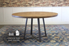 Round Industrial Steel Pedestal Table in Harvest Wheat Finish.
