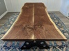 Book matched solid Black Walnut live edge slabs.