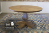 "54"" Knotty Alder Round Heirloom Pedestal Table in Harvest Wheat Finish."
