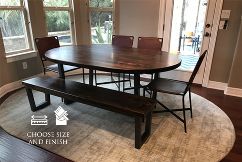 "72"" x 45"" Oval Steel Trestle Table in Tobacco Finish with a Trapezoid Base. Pictured with a Steel Trapezoid Bench."