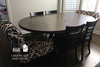 "72"" x 45"" W Oval Industrial Pedestal Table, Amelia Base, in a custom stain color."