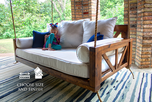 Avery Wood Porch Swing Bed Daybed in Tuscany Finish, Twin Mattress Size. Pictured with the Sketched Indoor / Outdoor Rug.