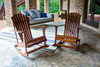 Outdoor Adirondack Rocker in Tuscany Finish. Tobacco Finished Rustic Chuck Pew and Tuscany Finished Avery Wood Porch Swing Daybed pictured in background.