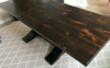 Jointed top (no grooves) on an Expandable Heirloom Pedestal Table with leaf inserted in Tobacco Finish.