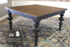 "55"" x 55"" Square Olivia Modern Turned Leg Table with a jointed top in Dark Walnut stain with a Black painted base."