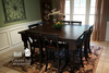 """66"""" x 66"""" x 36"""" H Counter Height Square Table with Baluster Turned Legs in Kona Stain with a traditional top and endcaps. Paired with X-Back Stools."""