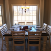 """66"""" x 66"""" Square Baluster Turned Leg Table with a traditional top in Kona stain with an Ivory painted base. Pictured with Thomas Chairs."""
