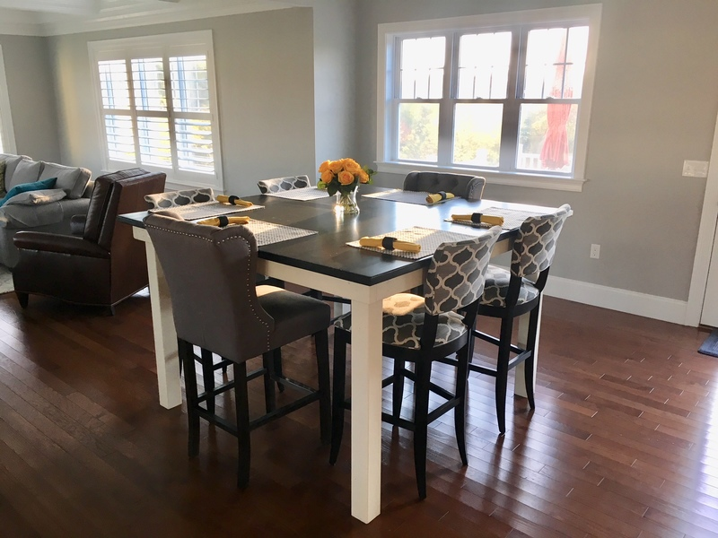 """66"""" x 66"""" x 42"""" H Square Farmhouse Table with a jointed top in Midnight Stain with an Ivory painted base."""