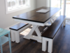 """7' x 37"""" Trestle Table with apron in Dark Walnut stain and ivory painted base with traditional boarded top. Picture with 2 matching farmhouse benches."""