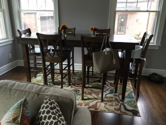 """7' L x 37"""" W x 42"""" H Farmhouse Table stained Dark Walnut. Pictured with Double X-Back Bar Stools."""