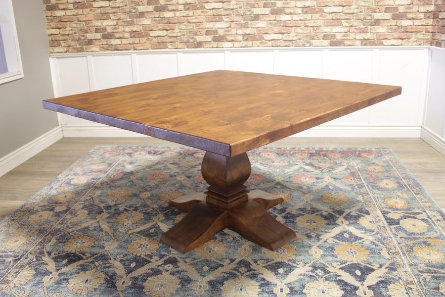 Square Heirloom Pedestal Table in Tuscany Finish with the top knots filled with epoxy.